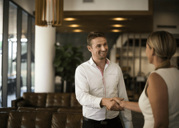 Man shaking hand in business hotel