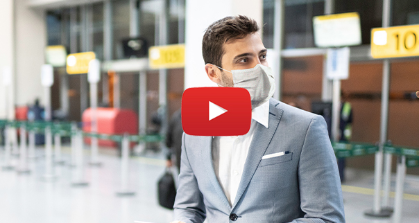 Man in airport with mask
