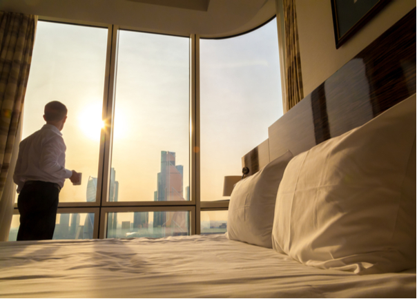 Man-in-Hotel-Room-At-Sunrise