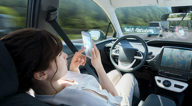 woman on phone self driving car